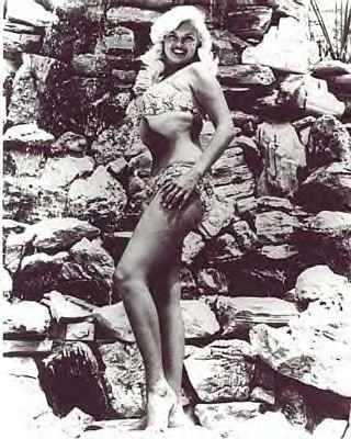 Jayne Mansfield by the waterfall near her pool.